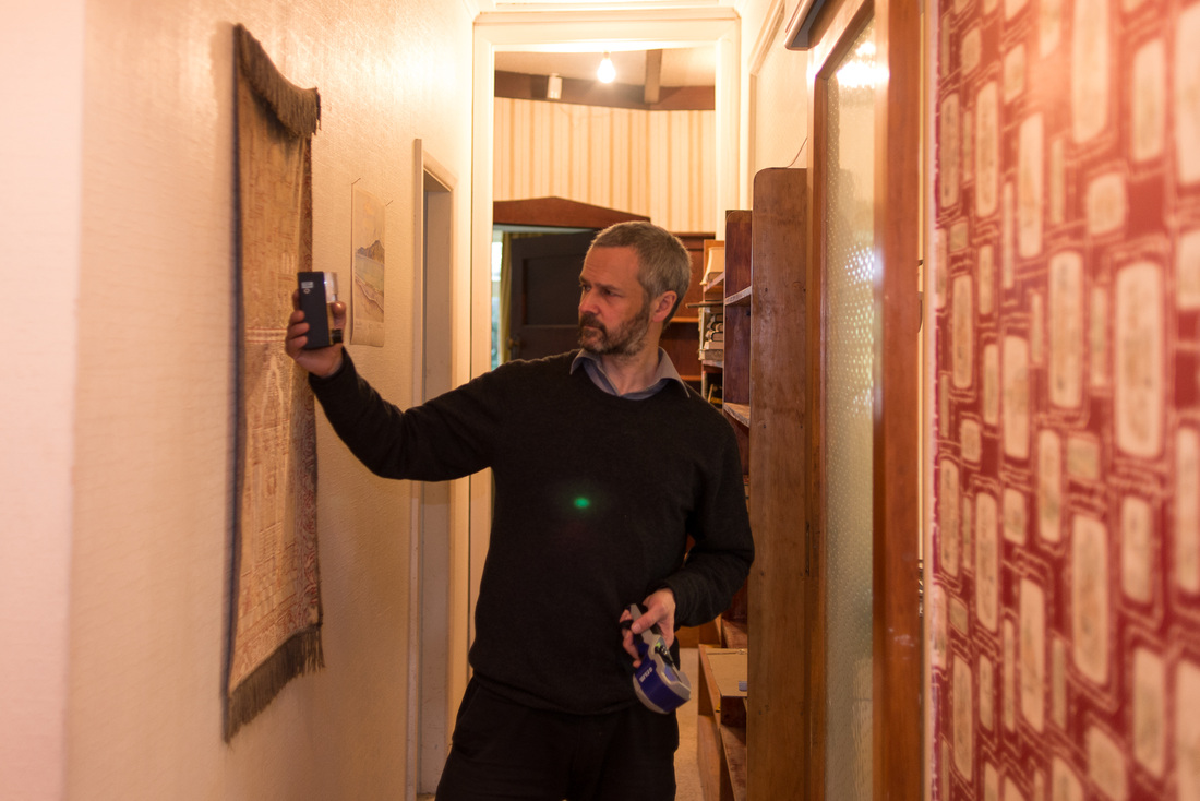 PictureHouse investigation, using Trifield EMF meter. Strange green light intrudes, green orb, Strange Occurrences paranormal investigators, Wellington New Zealand, photo by Karen Lee